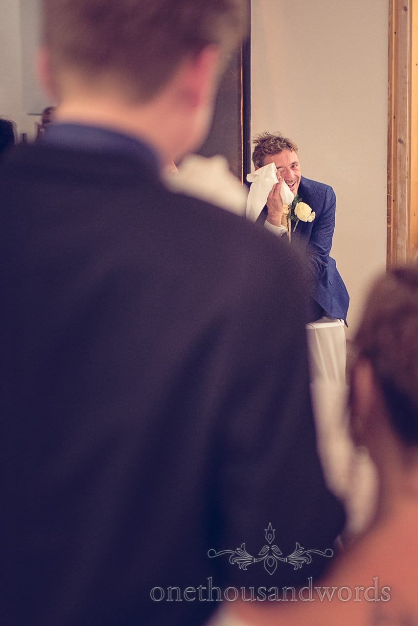 Groom crying during wedding speeches at Bled Castle in Slovenia