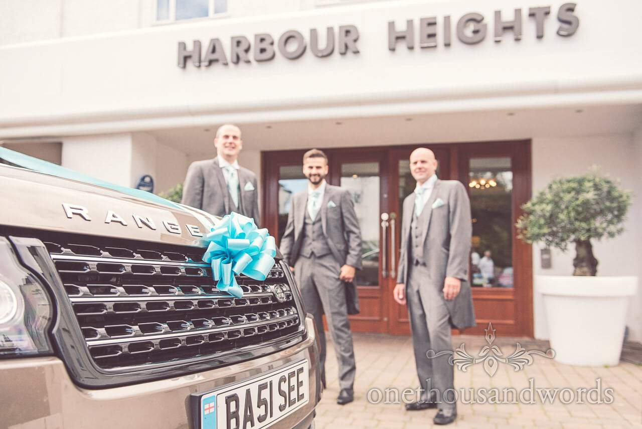 Groom, groomsmen and wedding car at Harbour Heights wedding