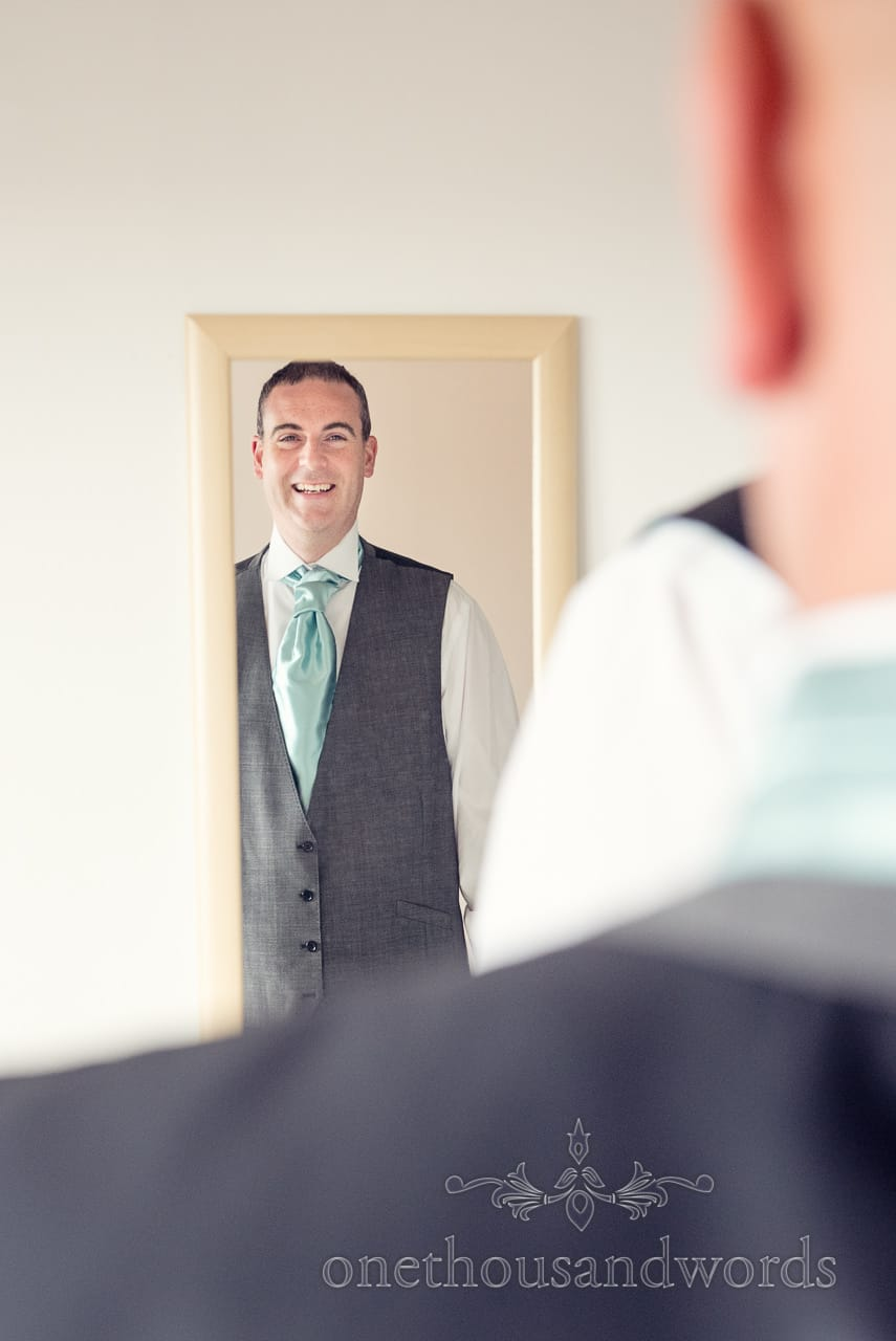 Groom in the mirror from Harbour Heights wedding