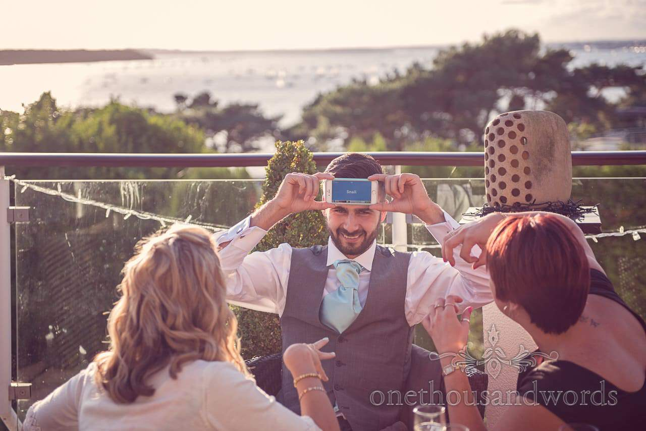 Groomsman and guests play game at Harbour Heights Outdoor Wedding