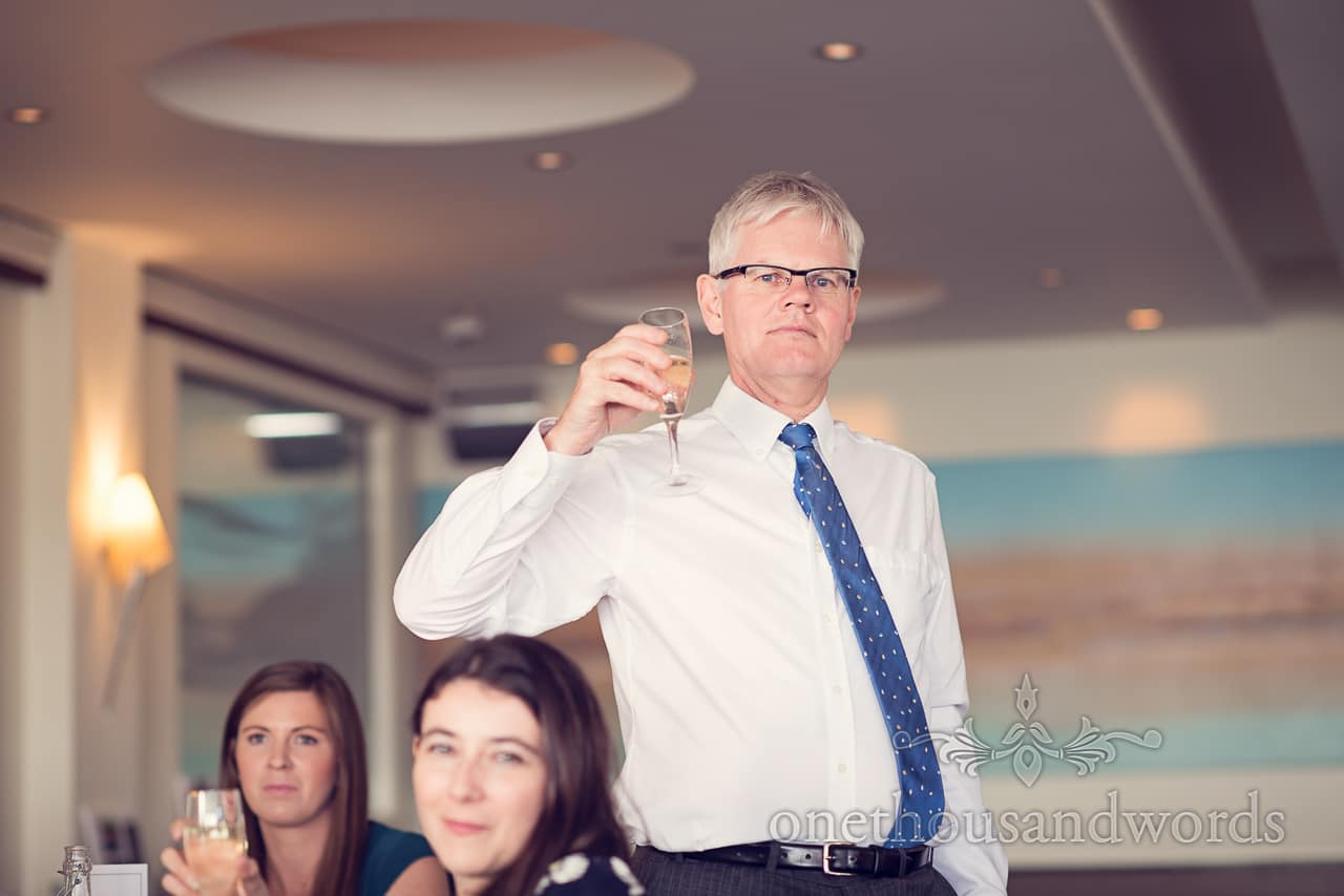 Guest raises glass for toast at Harbour Heights wedding