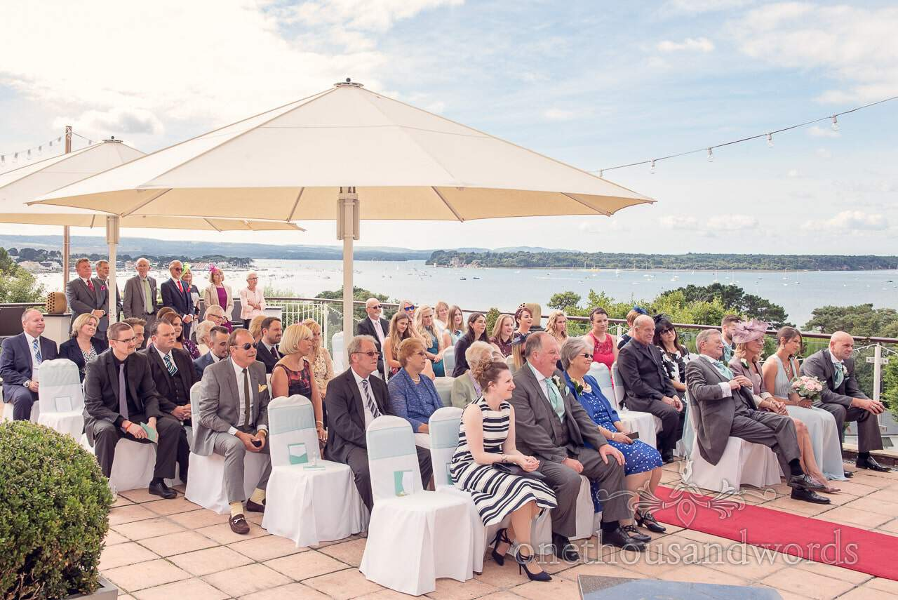 Guests seated on private terrace at Harbour Heights Hotel outdoor wedding