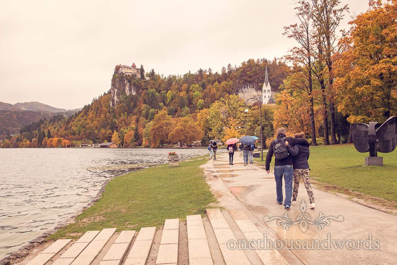 Lake Bled and Bled Castle in the autumn with bride and groom on wedding morning