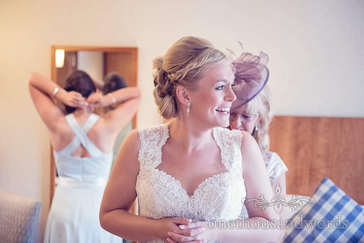 Mother adjusts brides dress at Harbour Heights wedding