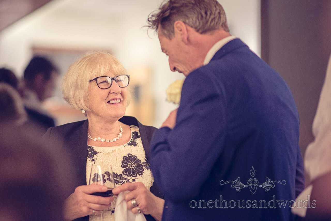 Mother of the bride laughs with groom at destination wedding in Slovenia