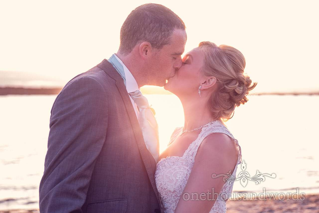 Newlyweds kiss at sunset from Harbour Heights outdoor wedding