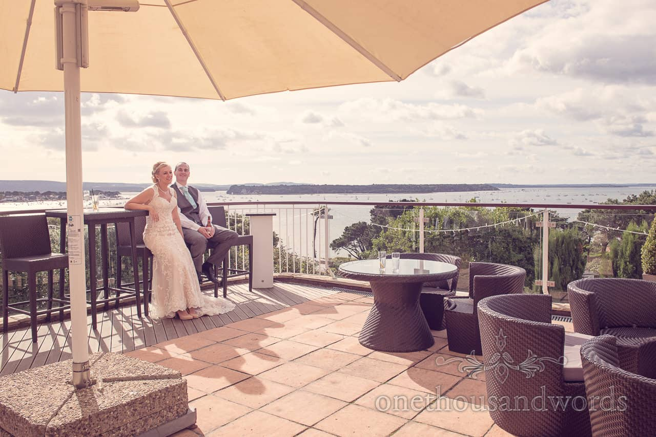 Newlyweds on the terrace at Harbour Heights outdoor wedding