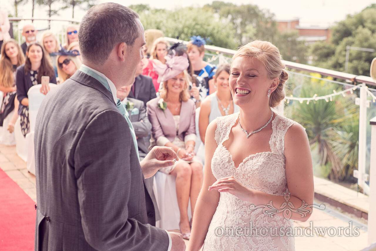 Exchange of the rings at Harbour Heights Hotel outdoor wedding