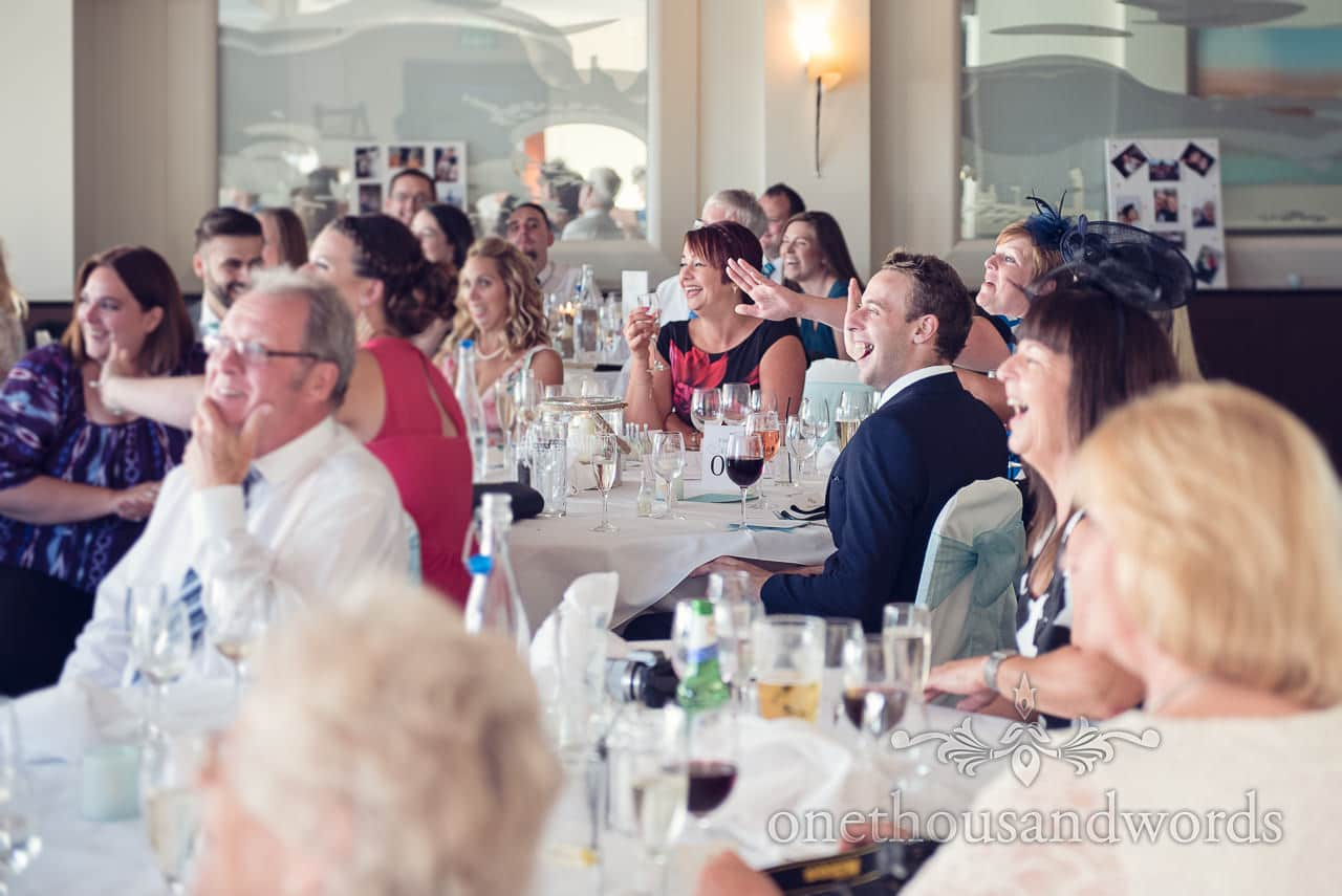 Seated guests react to best man speech at Harbour Heights wedding