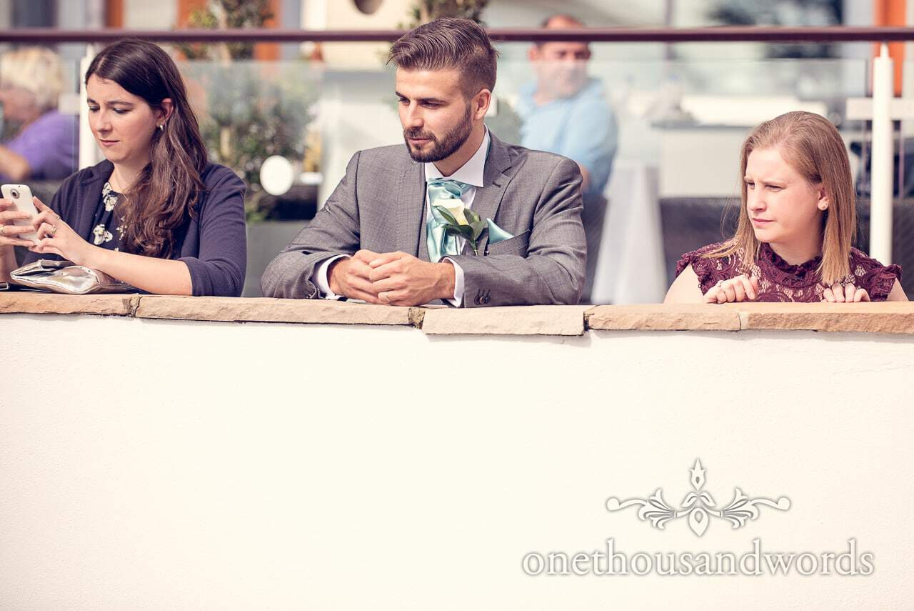 Usher and guests on terrace at Harbour Heights Hotel outdoor wedding