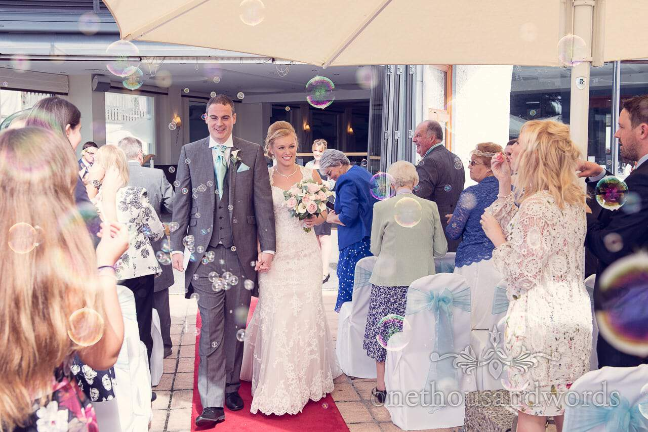 Wedding bubbles for newlyweds at Harbour Heights Hotel outdoor wedding