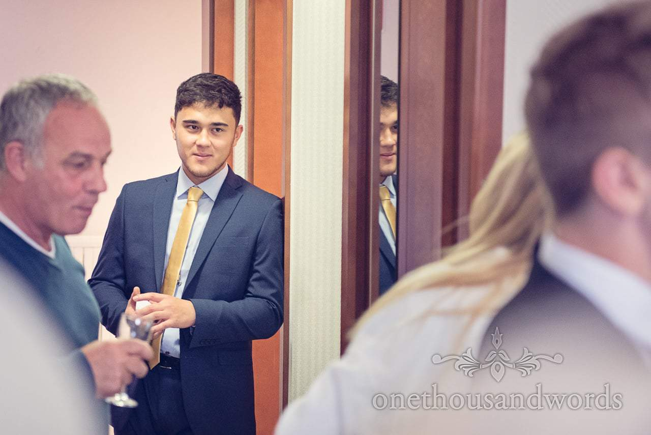 Wedding gues in gold tie watches bridal morning preparations in Hotel Kompass, Bled
