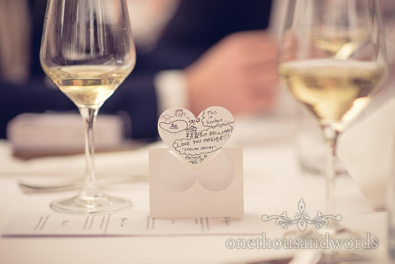 Wedding message on table place name love heart at Castle Bled wedding, Slovenia