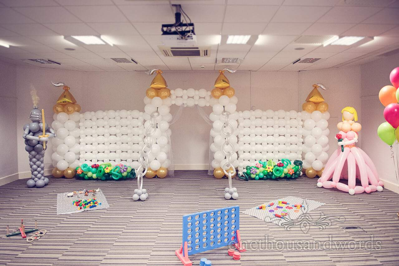 Balloon castle, knight and princess at child care room at Northcote House wedding