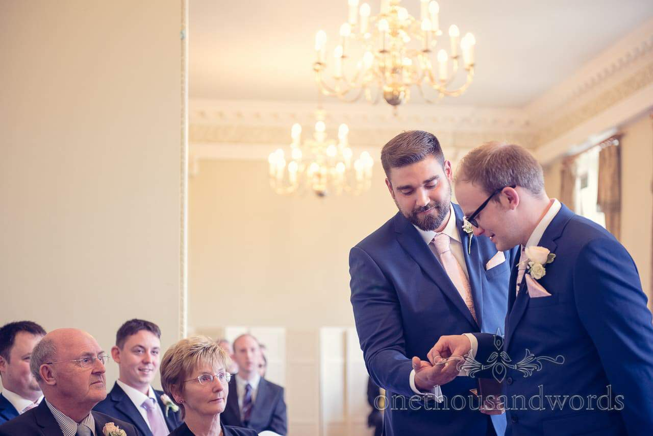 Best man give groom weddign rings at Northcote House wedding ceremony