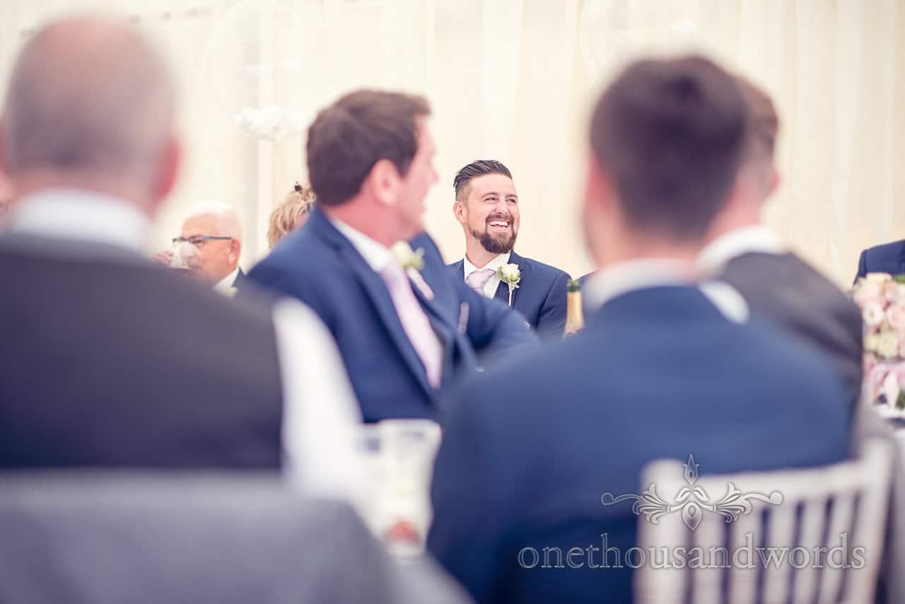 Best man reaction during speeches from Holme for Gardens Dorset wedding