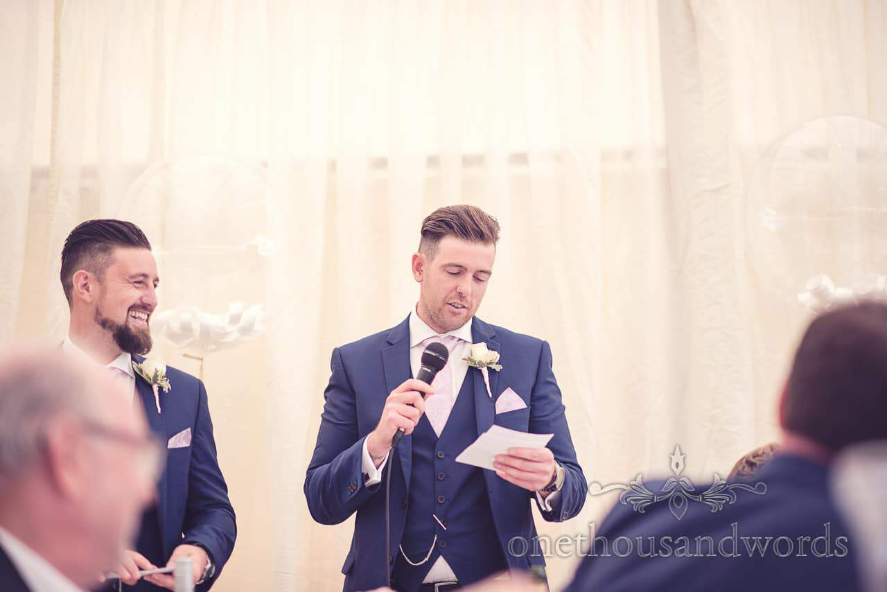 Best man reads speech at Holme for Gardens Dorset wedding