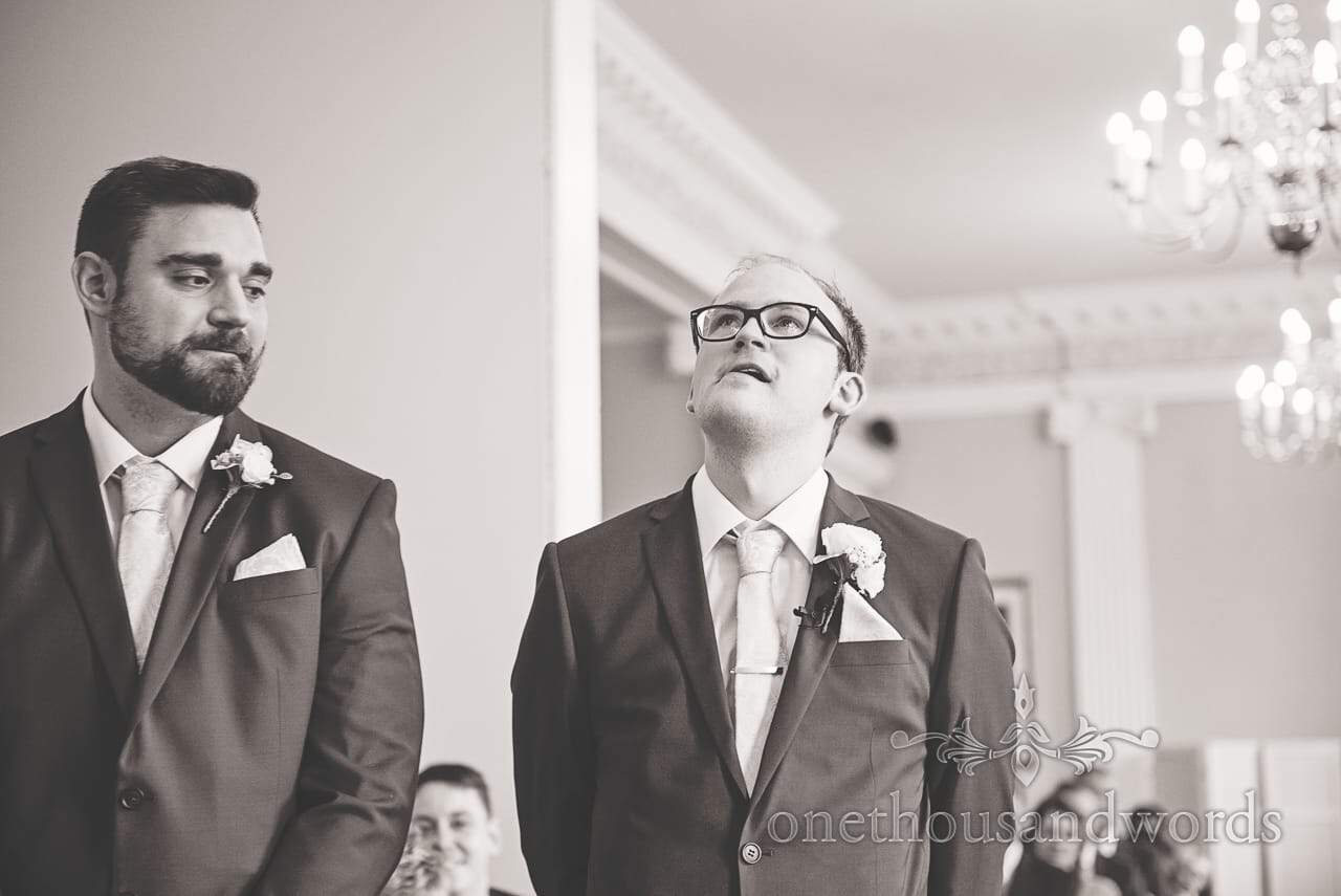 Black and white wedding photograph of nervous groom before wedding ceremony