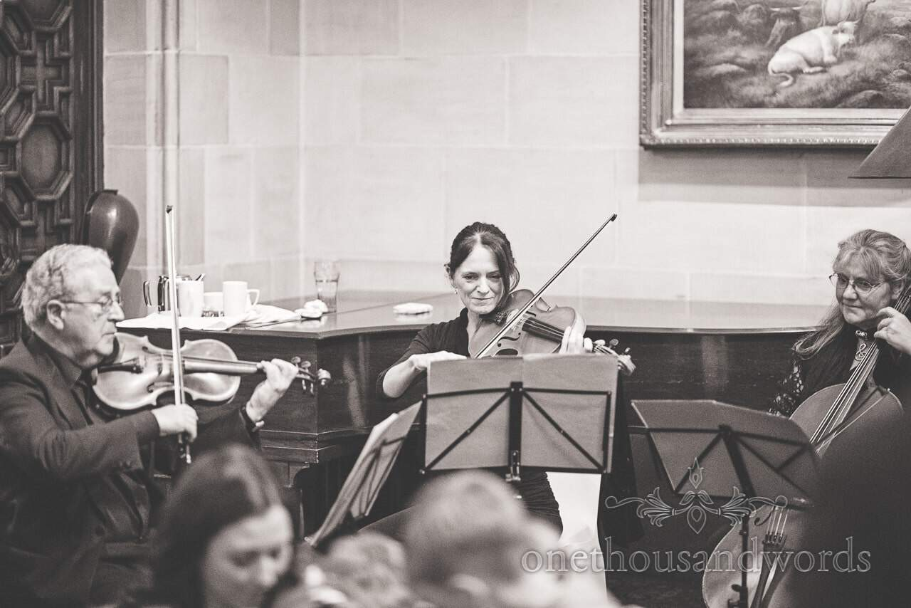 Black and white wedding photograph of string trio at Northcote House wedding