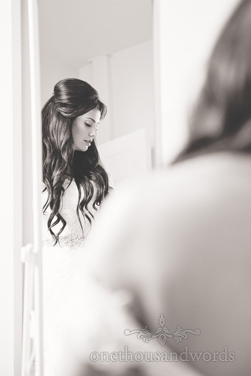Black and white wedding portrait of bride in mirror at Froyle Park wedding