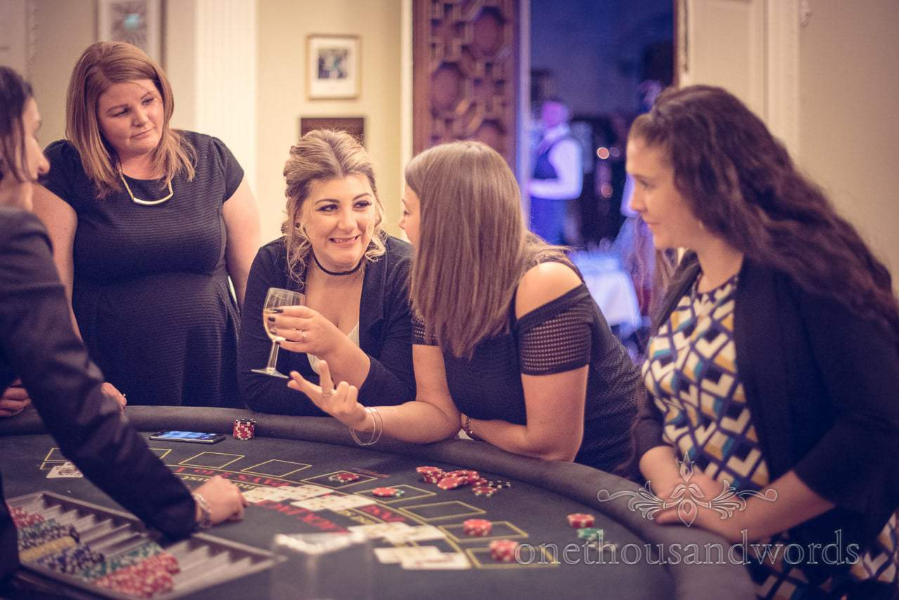 Blackjack table with female wedding guests at wedding casino