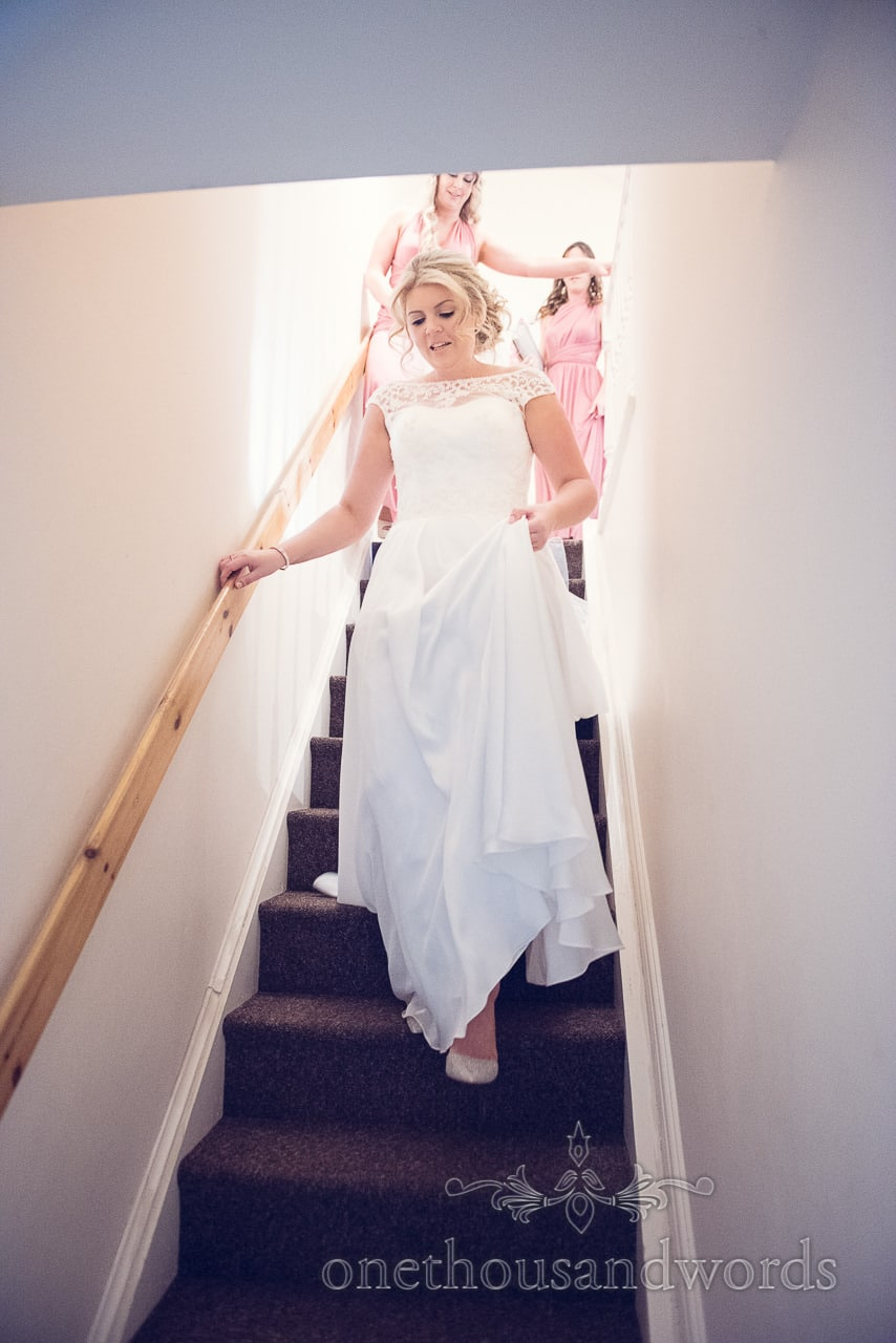 Bride and bridesmaid ascend the stairs before Holme for Garden wedding