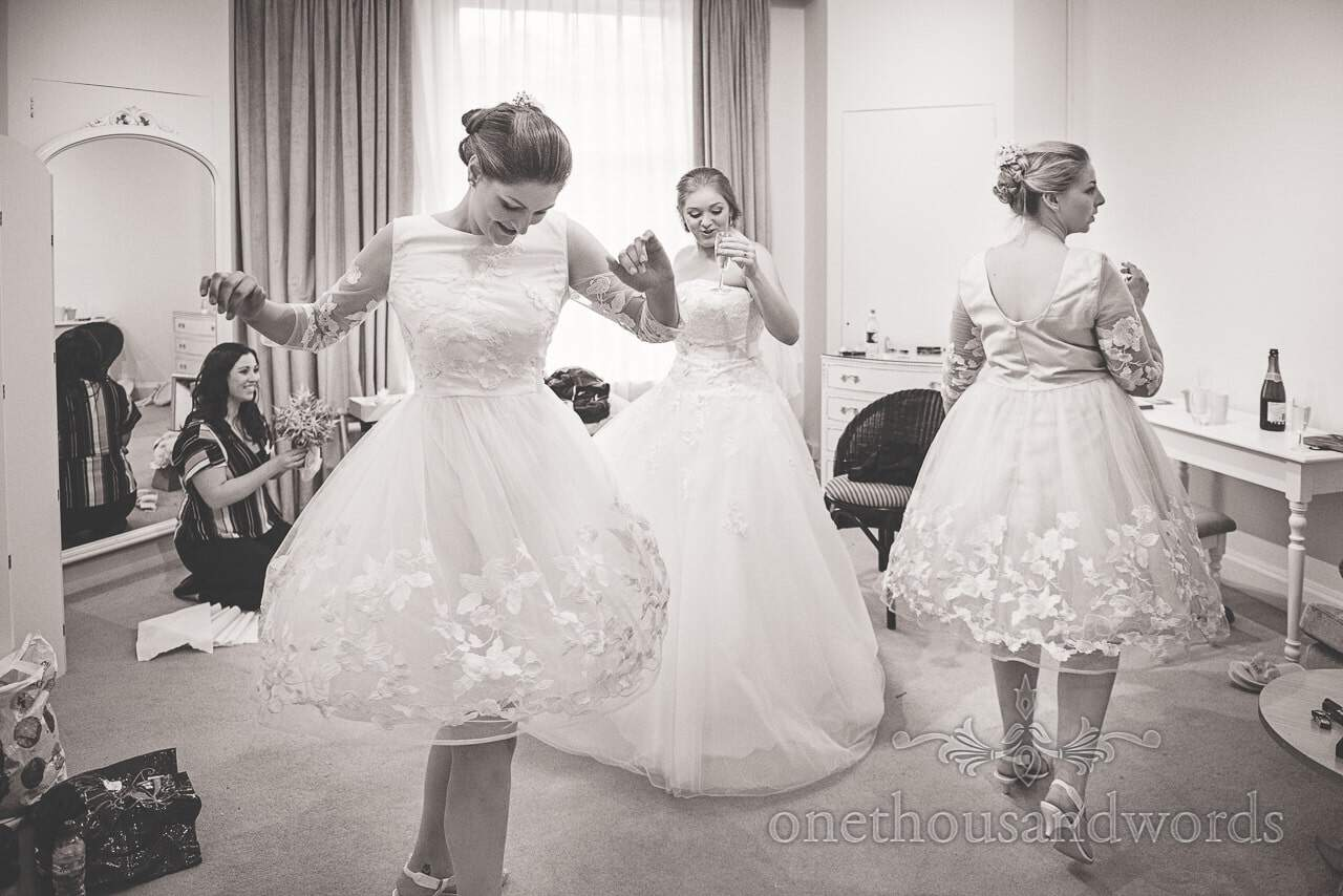 Bride and bridesmaids dance with prosecco during bridal preparations at Northcote House
