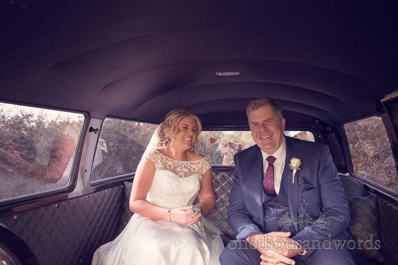 Bride and father on route to Holme for Gardens Dorset wedding