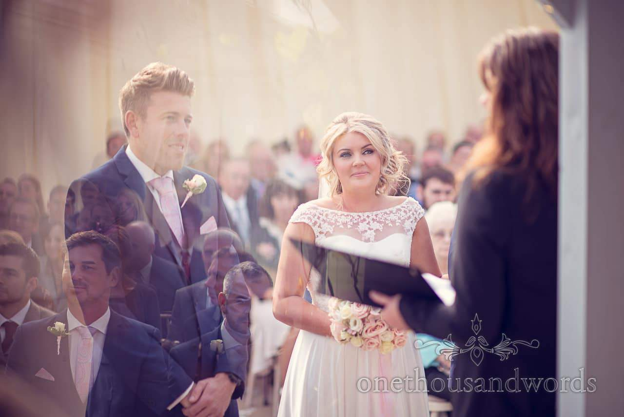 Bride and groom at ceremony at Holme for Gardens Dorset wedding