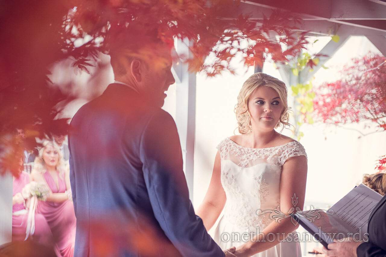 Bride and groom during ceremony at Holme for Gardens Dorset wedding
