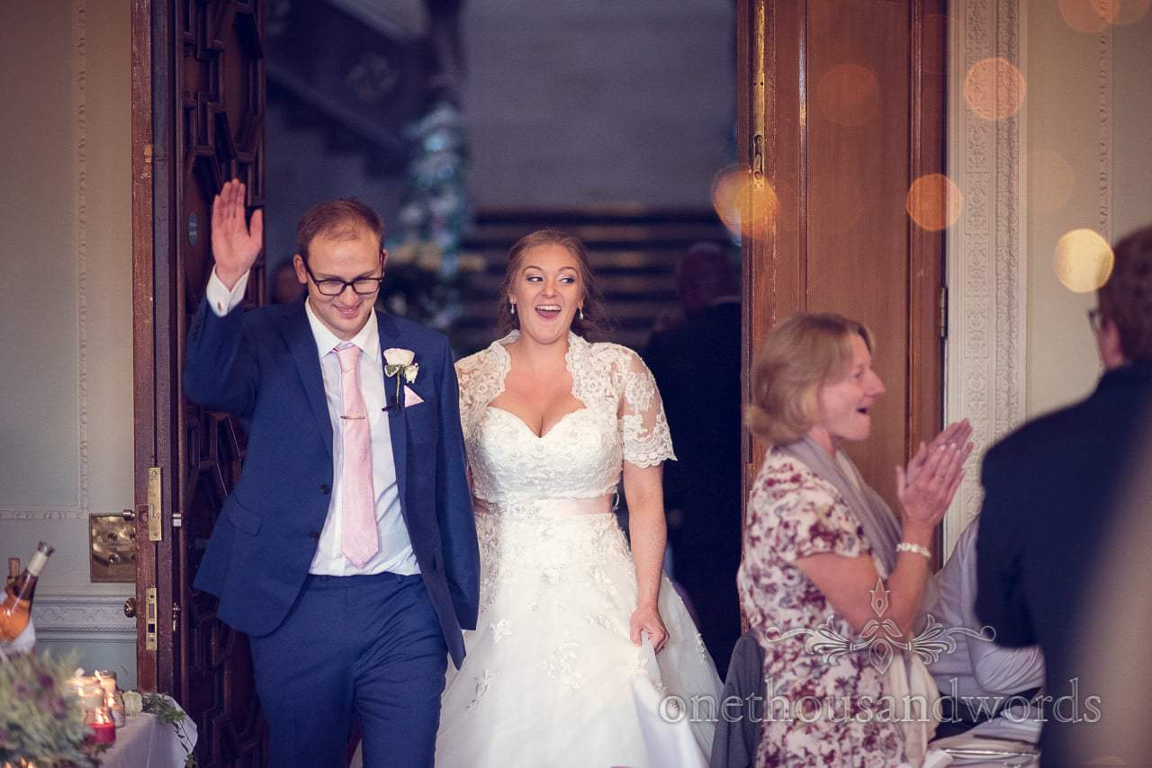 Bride and groom enter wedding breakfast at Northcote House wedding photographs