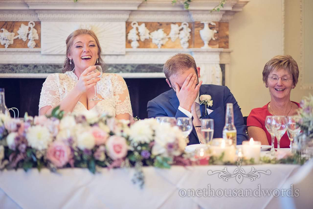 Bride and groom react to best man's speech at Northcote house wedding photographs