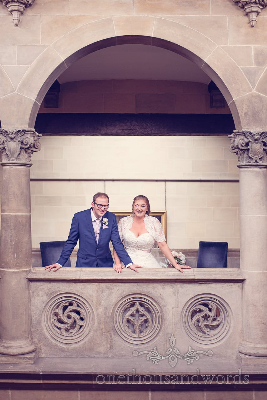 Bride and groom under stone archway at Northcote House wedding photographs
