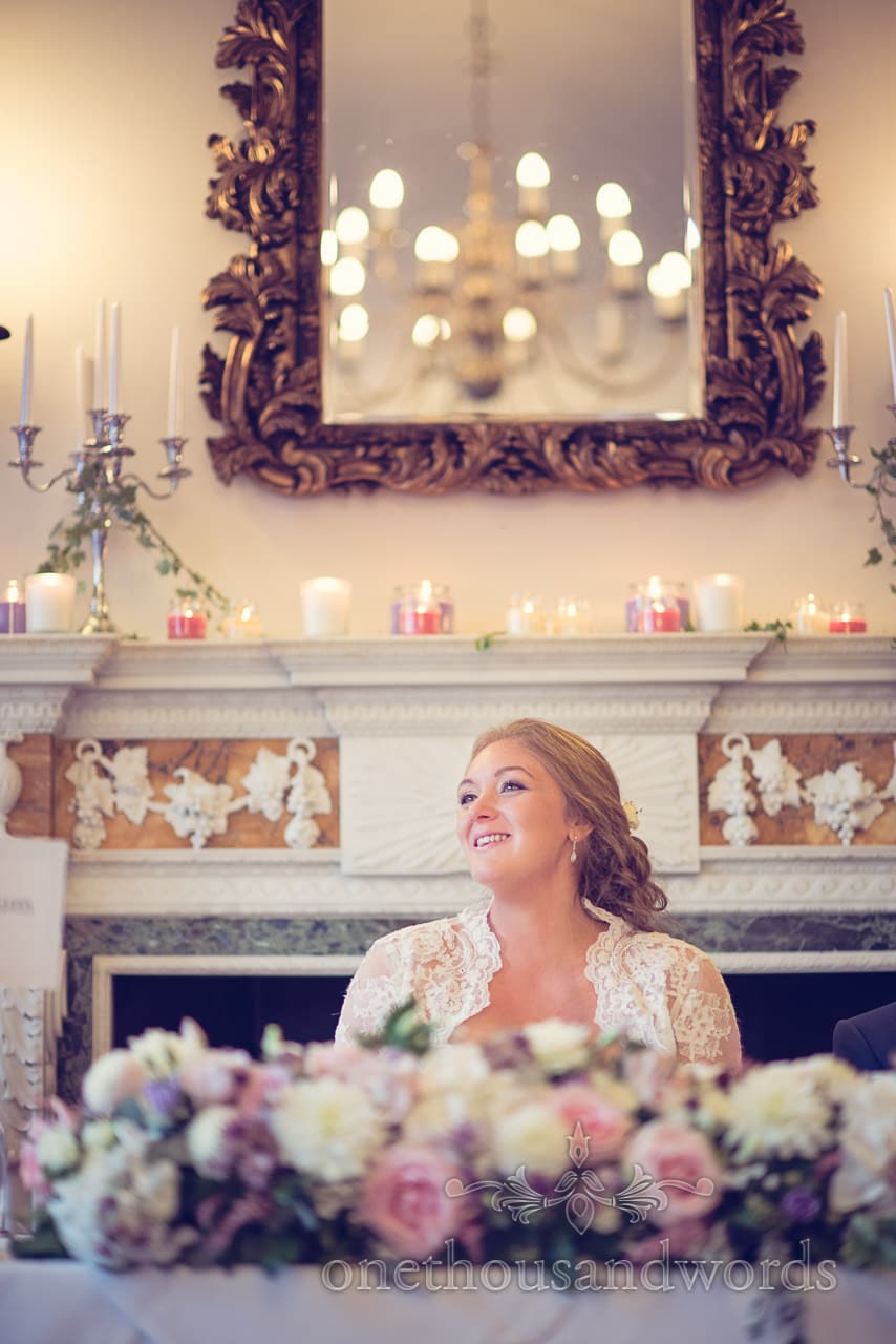 Bride at top table with mirror laughing at speeches at Northcote house wedding