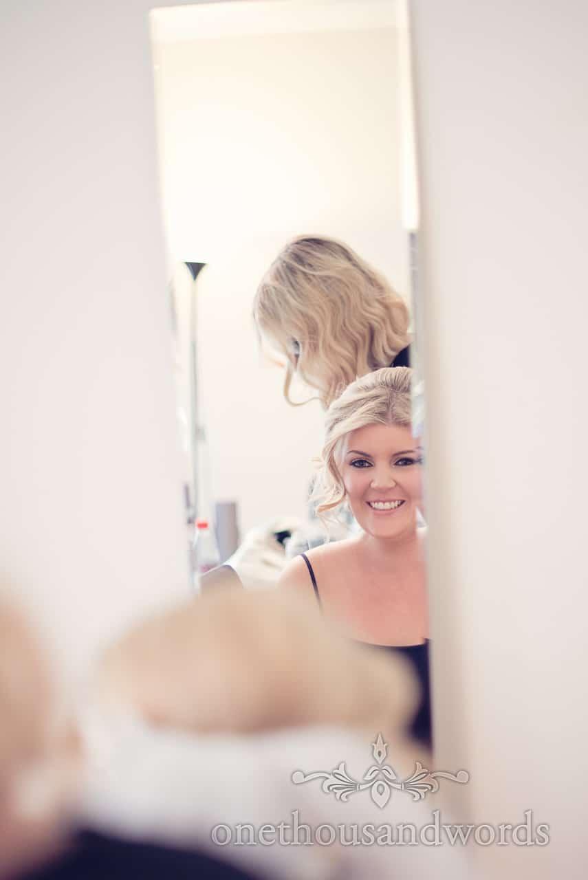 Bride in mirror before Holme for Gardens wedding