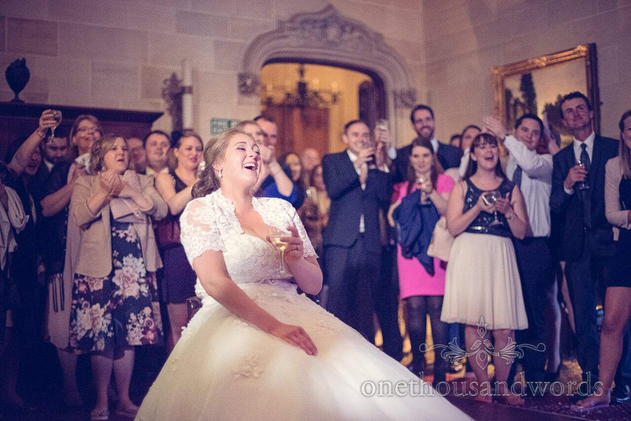 Bride laughing at groom's guitar solo during first dance at Northcote House wedding