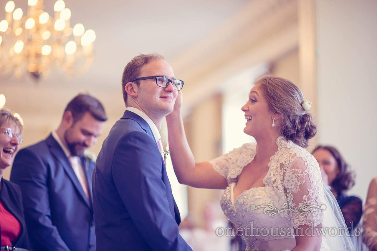 Bride laughs at groom during Northcaote House wedding ceremony