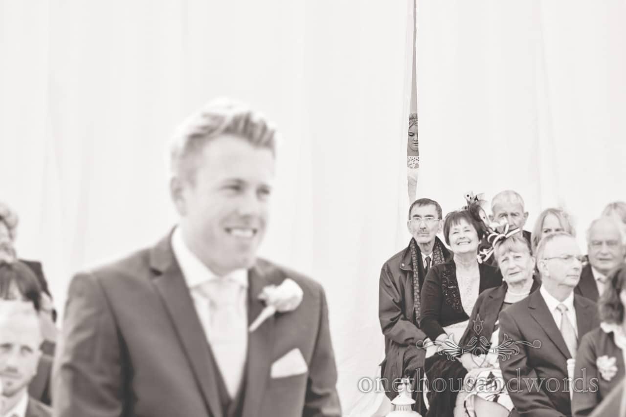 Bride waits behind curtain at Holme for Gardens Dorset wedding
