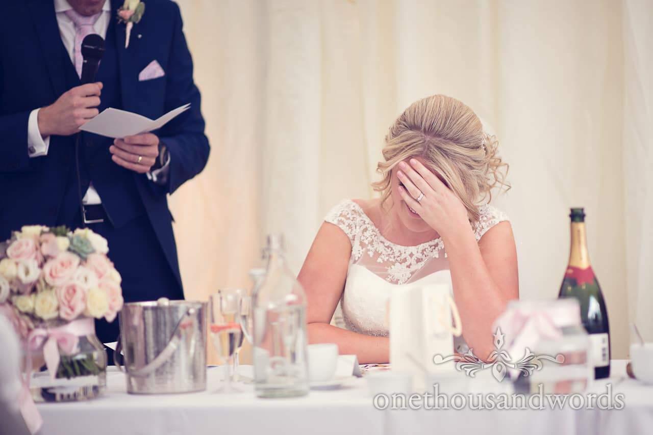 Brides reaction to grooms speech at Holme for Gardens Dorset wedding