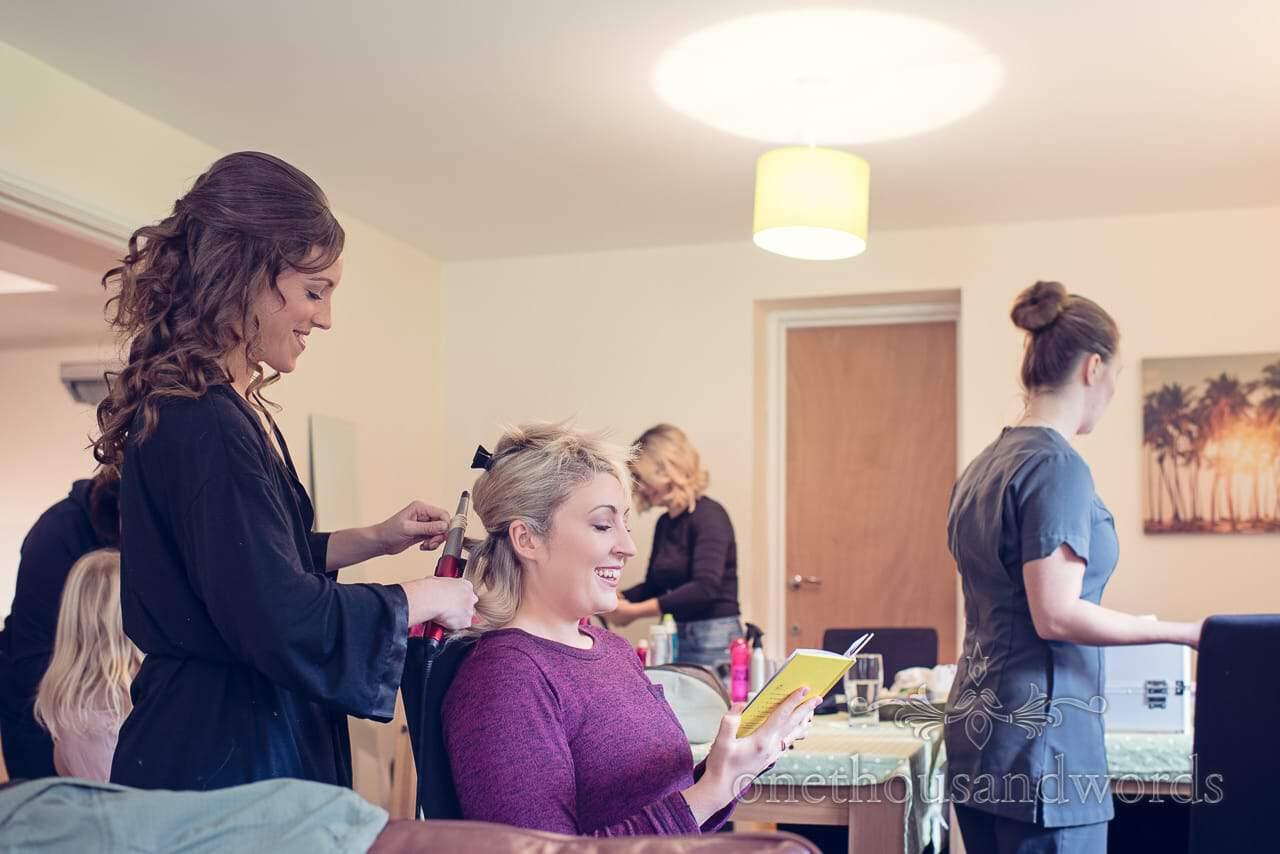 Bridesmaid curls hair before Holme for Gardens wedding