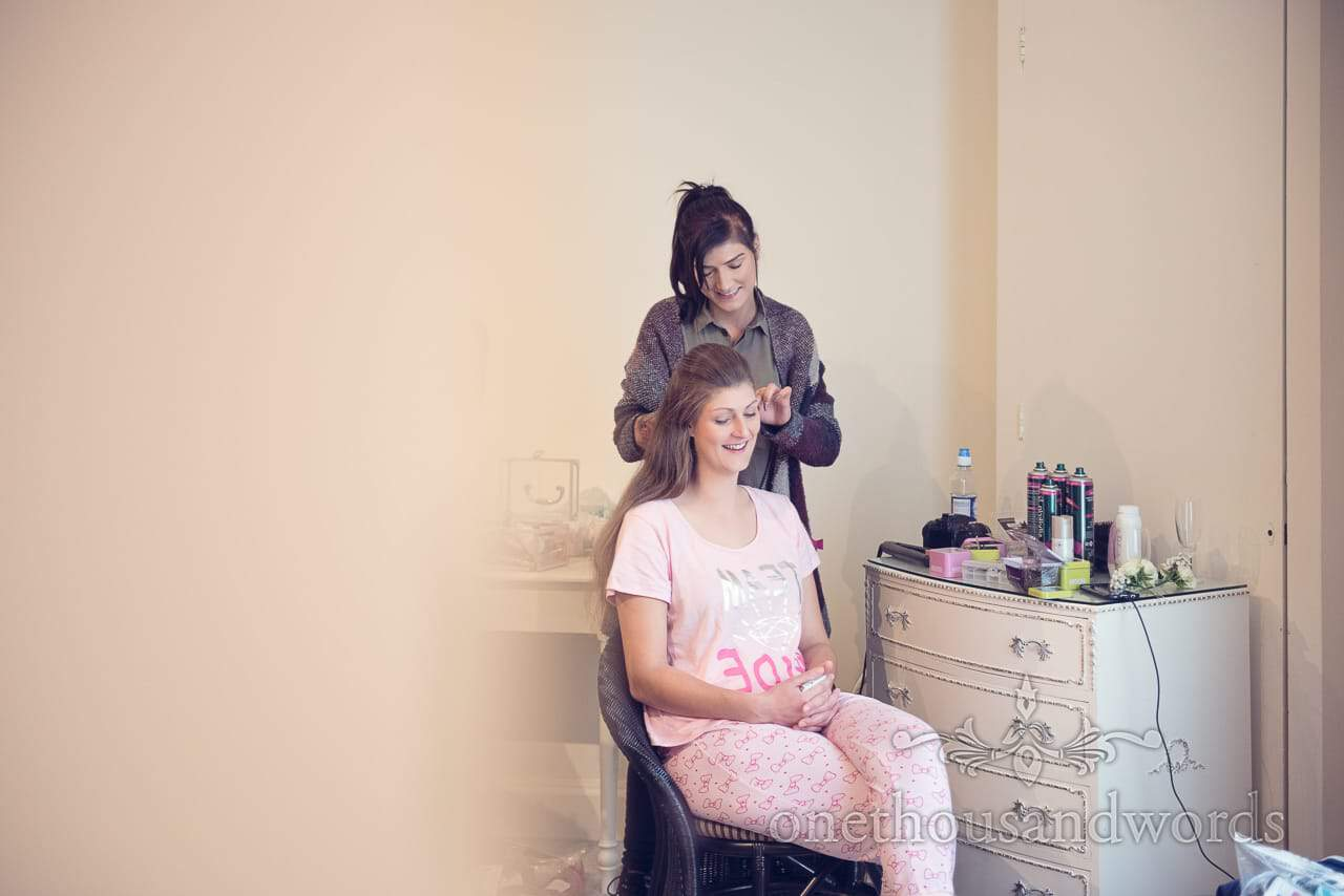 Bridesmaid has wedding hair styled by hairdresser at Northcote House wedding