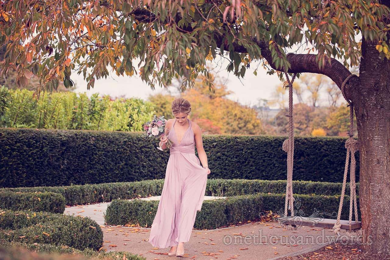 Bridesmaid in pink dress at Froyle Park wedding photographs