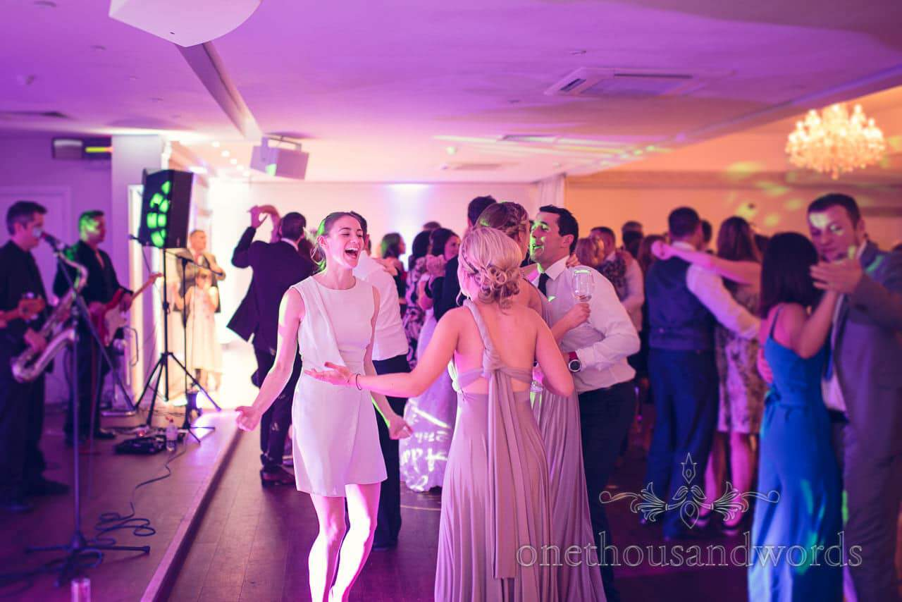 Bridesmaids and guest dance at Froyle Park wedding photographs