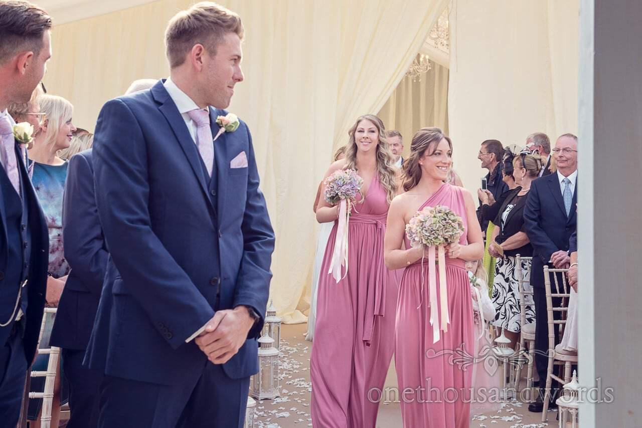 Bridesmaids come down the aisle at Holme for Gardens Dorset wedding