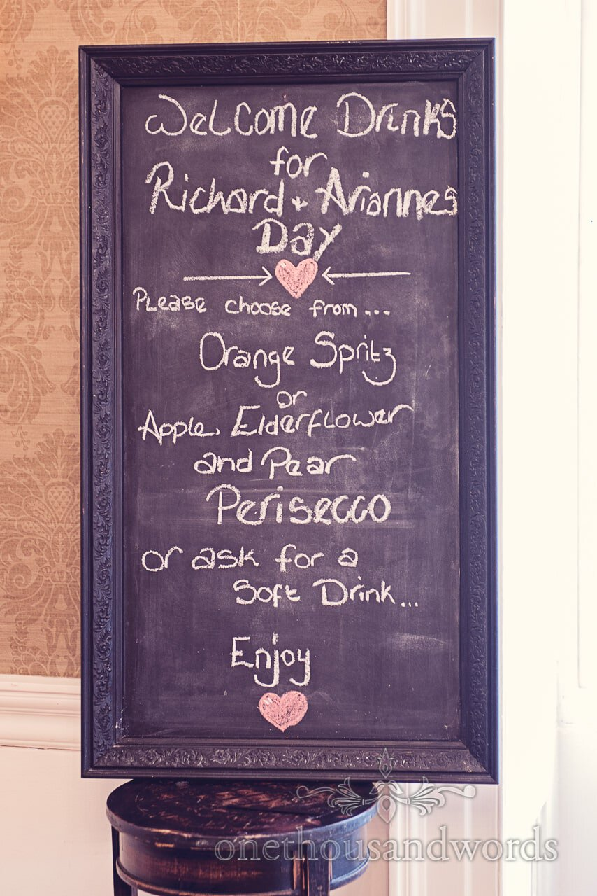 Chalkboard wedding drinks menu at Froyle Park wedding photographs