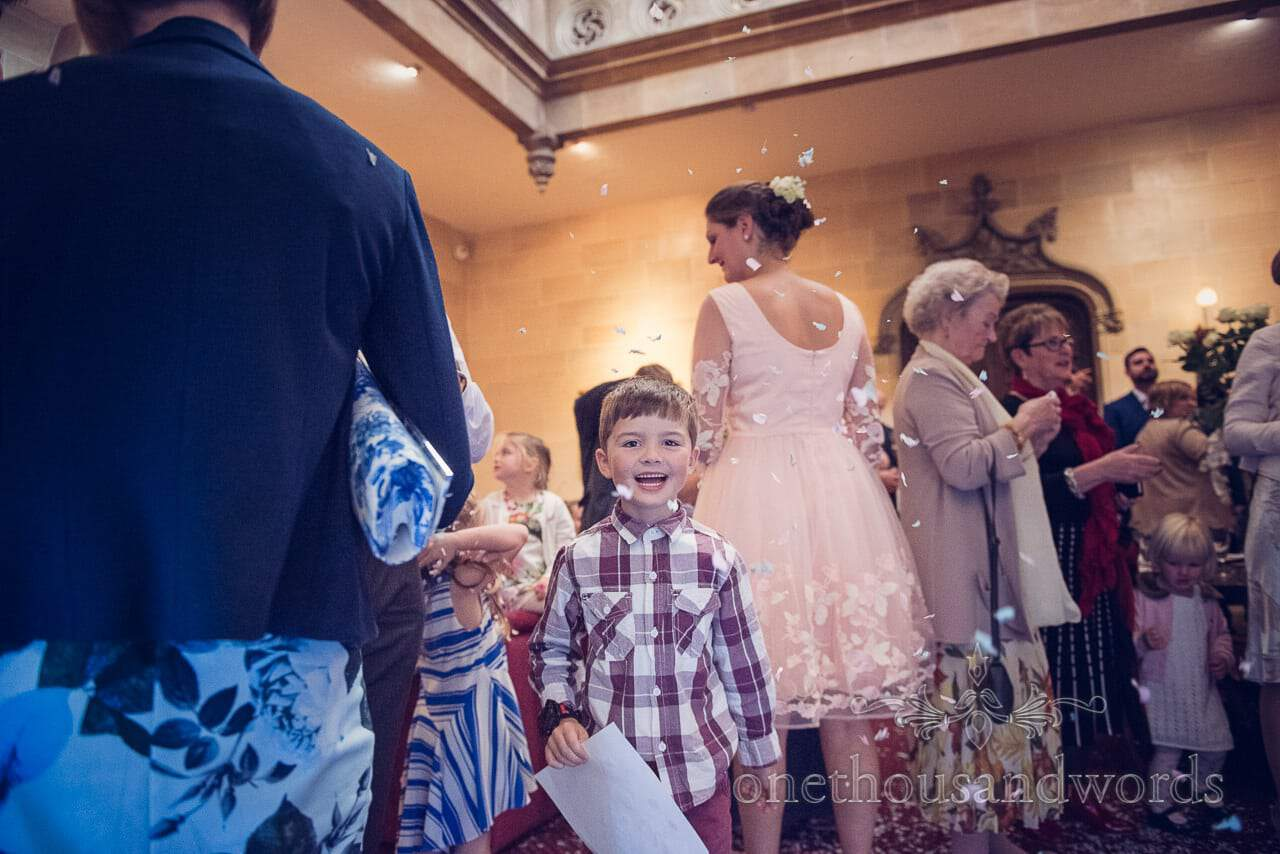 Child wedding guest with confetti at Northcote House wedding photograph