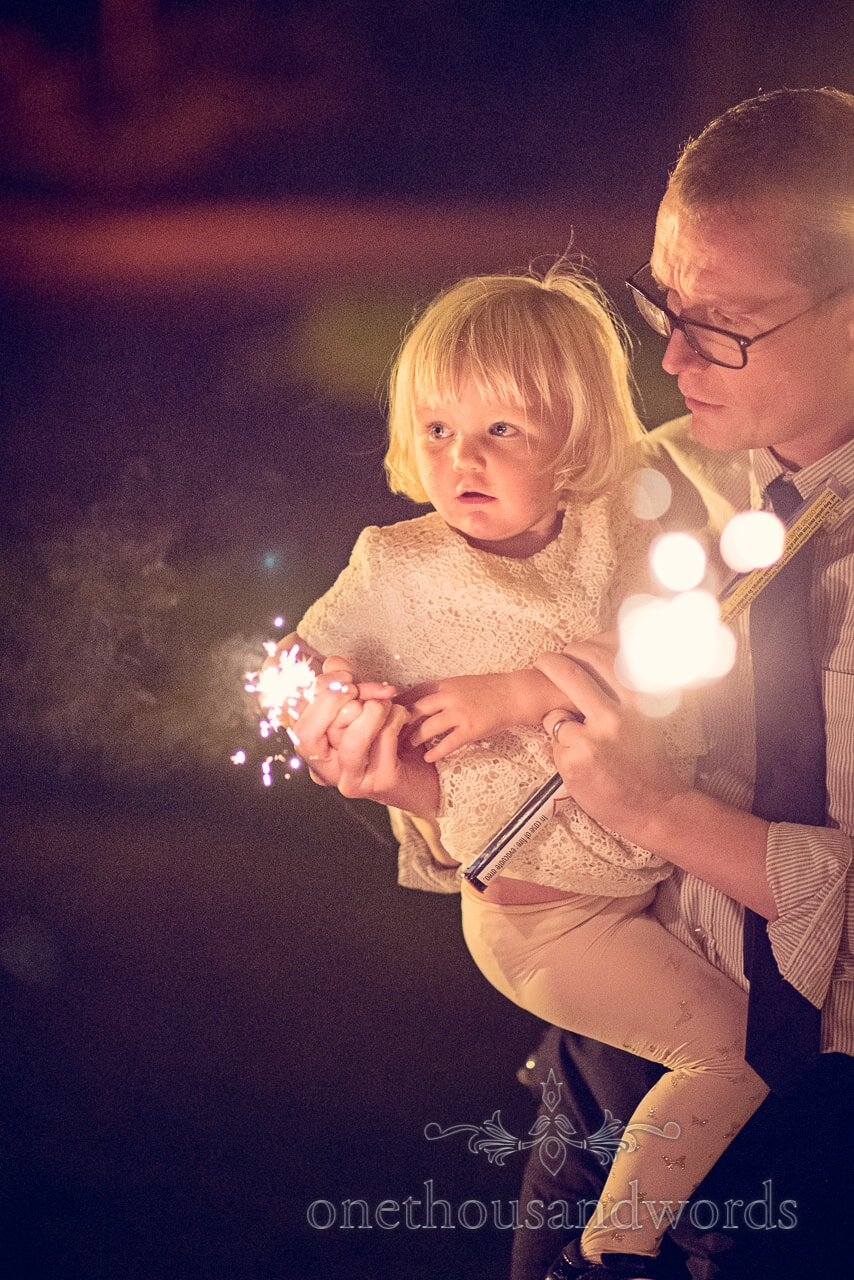 Child wedding guest with wedding sparklers at Northcote House wedding