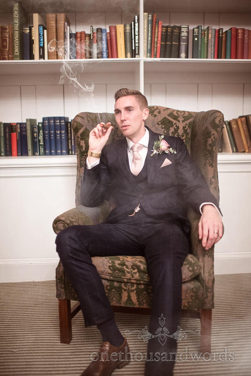 Cigar smoking groom at Froyle Park wedding photographs