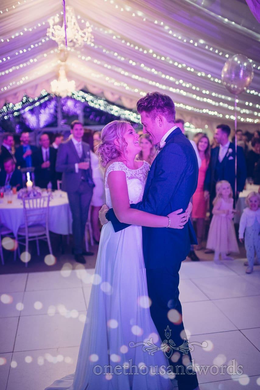 Couple embrace at Holme for Gardens Dorset wedding
