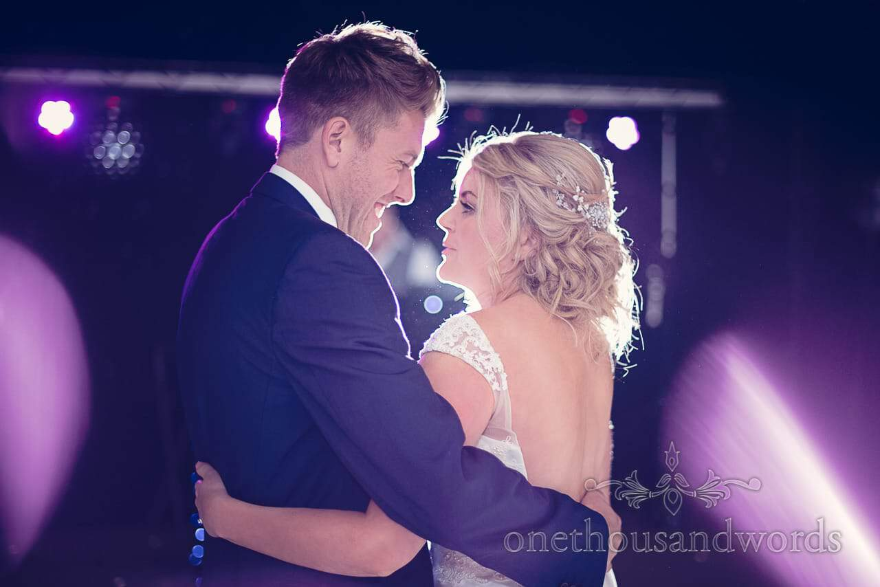 Couple embrace during first dance at Holme for Gardens Dorset wedding